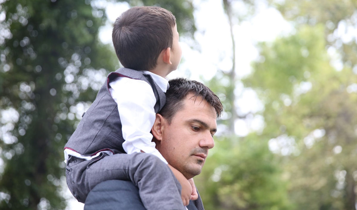 Boy riding on dad's shoulders